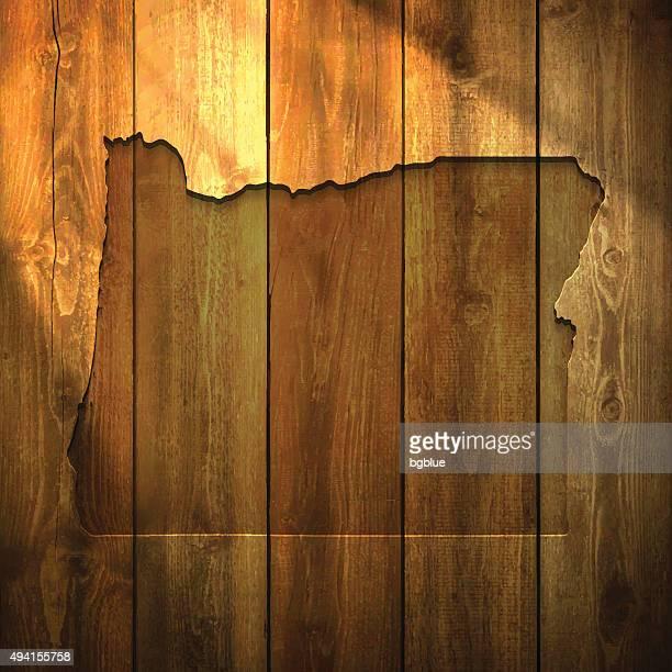 Oregon Map on lit Wooden Background