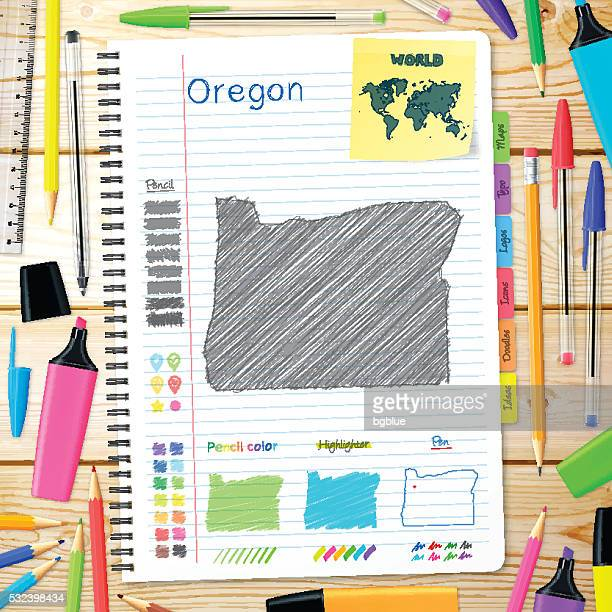 Oregon maps hand drawn on notebook. Wooden Background