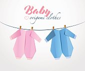 Origami Baby clothes from paper on clothes line