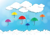 Origami made colorful umbrella and clouds background. Paper art style. Vector illustration