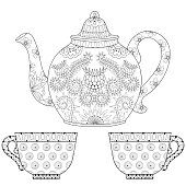 Ornamental teapot with cups of tea, hot bever