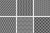Ornamental white floral pattern set on gray backgrounds