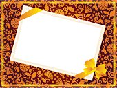 Ornate background with blank card and bow