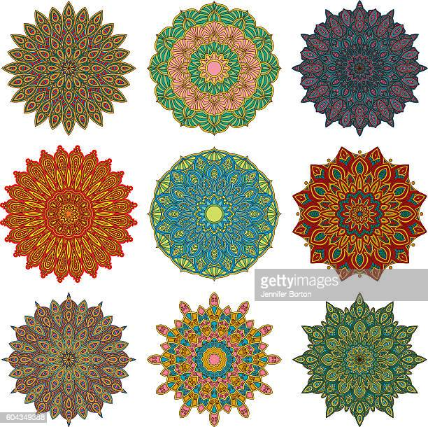 ornate circular mandala multicolored designs - mandalas india stock illustrations
