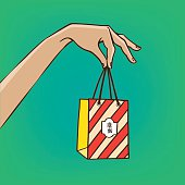 Outstretched hand with gift bag