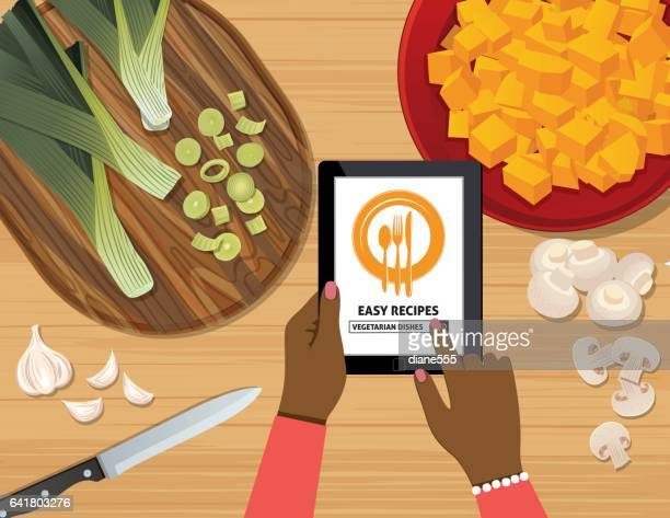 Overhead Angle Of A Person Using Apps Online For Cooking