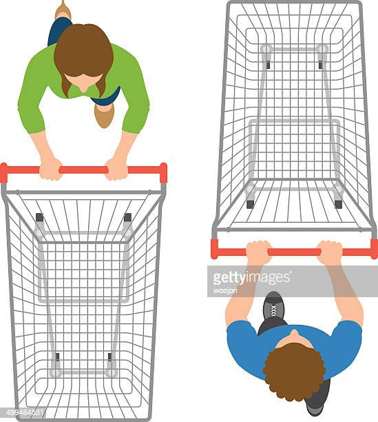 overhead view of man and woman pushing empty trolleys - shopping cart stock illustrations