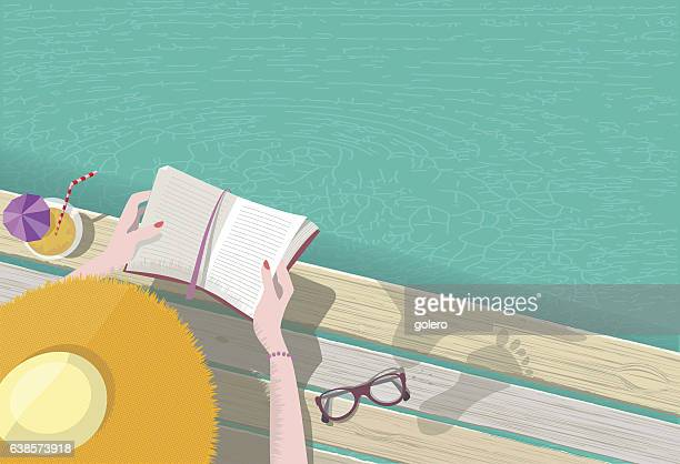 ilustrações, clipart, desenhos animados e ícones de overhead view on woman with hat reading at pool - literatura