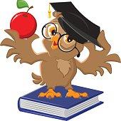Owl holding an apple