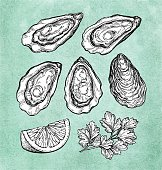 Oysters with lemon and parsley.