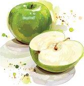 Painted green apple cut in half