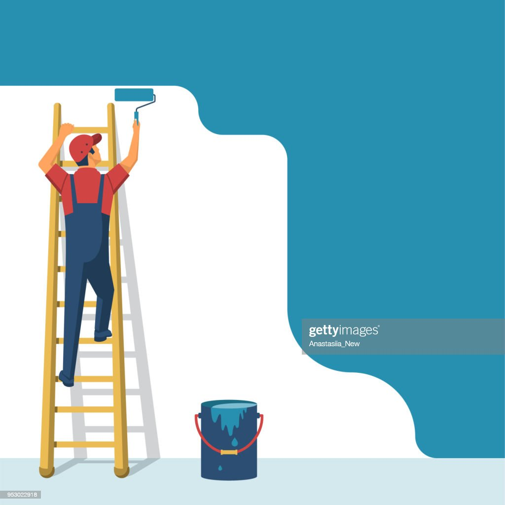 Painter standing on staircase paints the wall