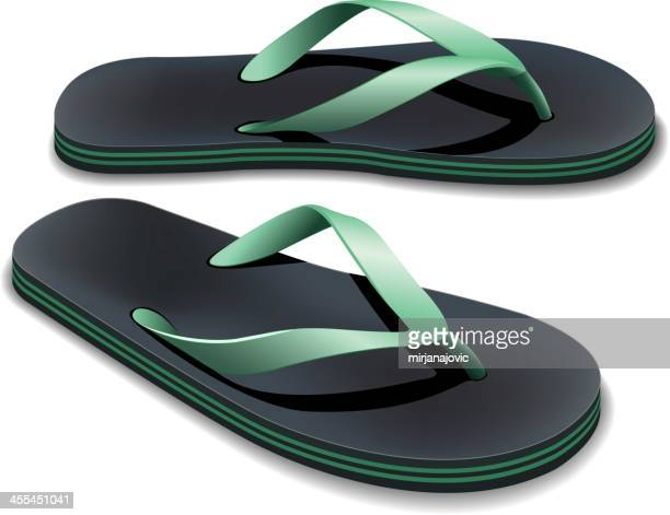 A pair of black and green flip flops