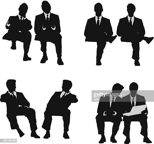 Pair of businessmen sitting