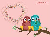 A pair of lovely owls in love, sit on a branch. Colorful confetti in the shape of heart. Greeting card for Valentine's Day and invitation to the wedding. The Vector