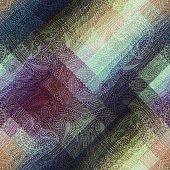Paisley symmetric pattern on pixel background.