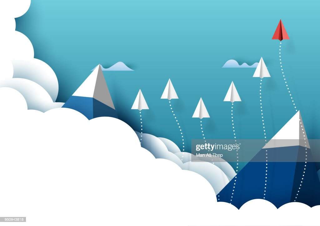 Paper airplanes flying from clouds and blue sky background
