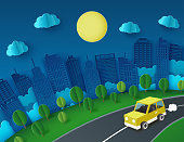 Paper art background with yellow car escape from the night city. Fluffy paper clouds, trees, moon and scyscrapers Vacation and travel concept. Vector illustration