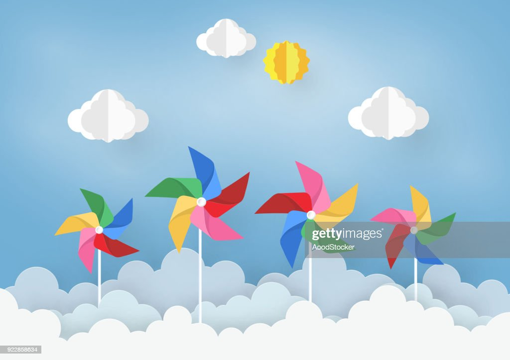 Paper Art  Design with Cloud and pinwheel  on light Blue background . the Concept is freedom or positive thinking ,vector design element illustration