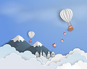 Paper art of blue sky background with white balloon and gift box floating in the air