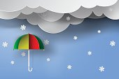 paper art of colorful umbrella with winter season,snow,blue sky,vector