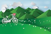 Paper art of green grass and mountains on a cloudy sky. Summer landscape. Natural vector illustration.