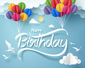 Paper art of happy birthday calligraphy hand lettering hanging with colorful balloon