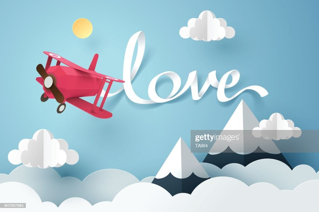 Paper art of love calligraphy and lettering hang with a pink plane flying in the sky, origami and valentines day conceptPaper art of love calligraphy and lettering hang with a pink plane flying in the sky, origami and valentines day concept