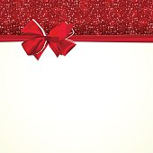 Paper card with ribbon and tied bow.