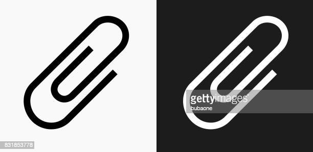 paper clip icon on black and white vector backgrounds - paper clip stock illustrations, clip art, cartoons, & icons
