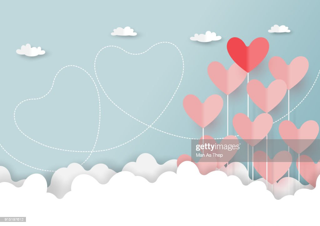 Paper cut of hearts on cloud and blue sky