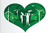 Paper cut style of  family having fun playing in the heart green town