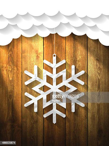 Paper Flake on wooden Background