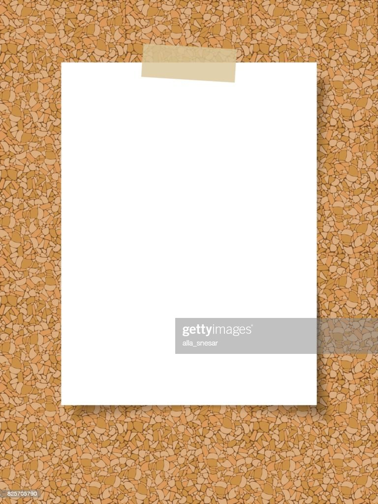 Paper on the background of a cork board