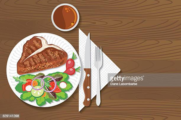 paper plate of food on a wood background - steak plate stock illustrations, clip art, cartoons, & icons