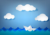 Paper scenery, origami boat in the sea