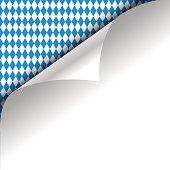 Paper upper left corner on a german Oktoberfest background.