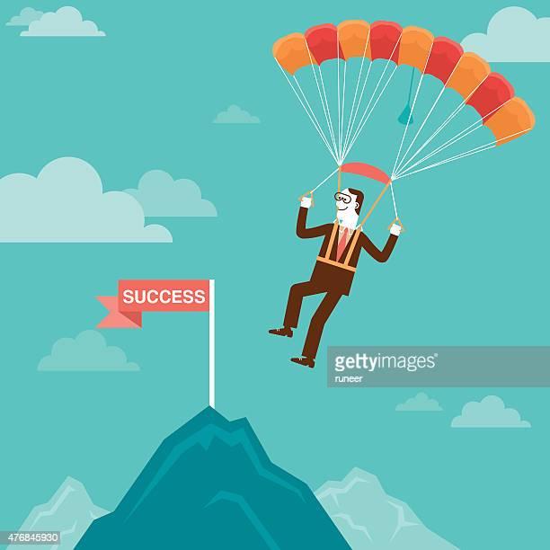 Parachuting Businessman Landing on Mountain Peak   New Business Concept