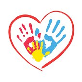 Parent's and kid's hands in a heart