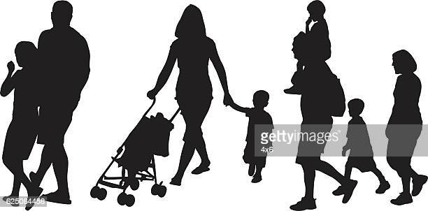 Parents walking with their child