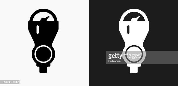 parking meter icon on black and white vector backgrounds - parking meter stock illustrations