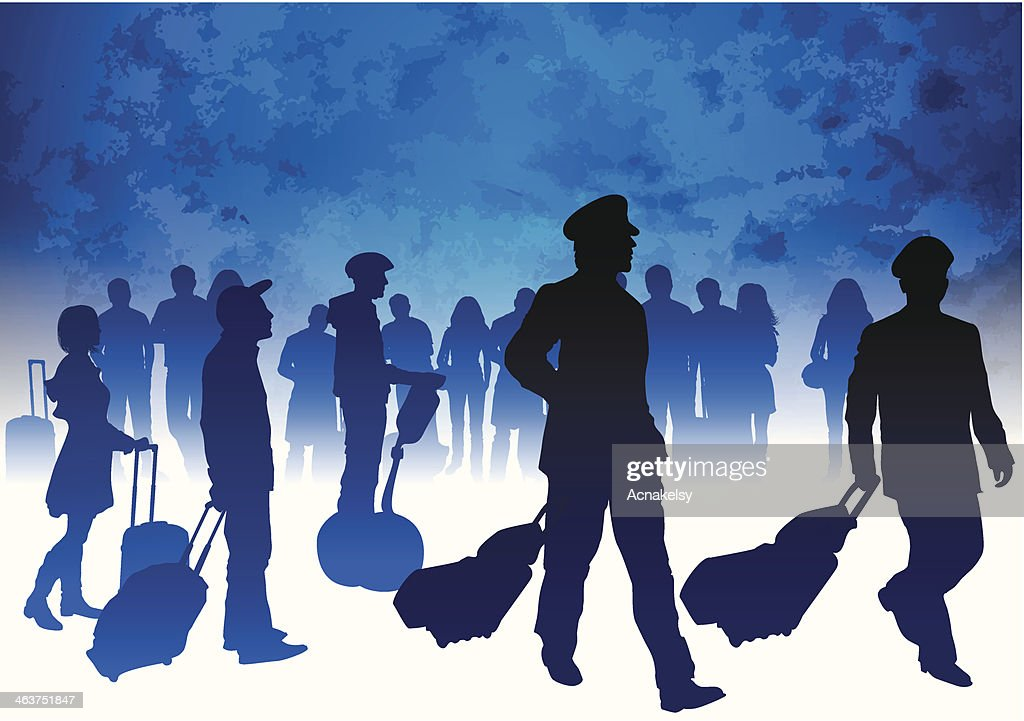Passengers and airline pilots with luggage in airport