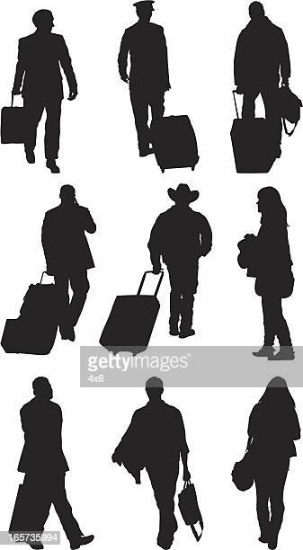 Passengers with luggage at an airport