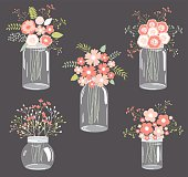 Pastel flowers in mason jars