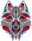 Patterned colored head of the wolf. Vector illustration
