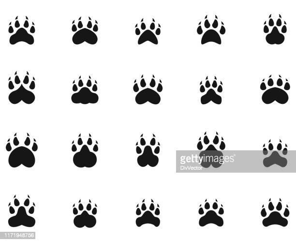 paw print icons - bear tracks stock illustrations
