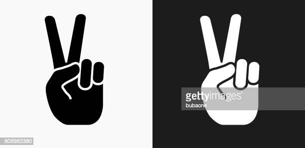 peace sign icon on black and white vector backgrounds - peace sign stock illustrations, clip art, cartoons, & icons