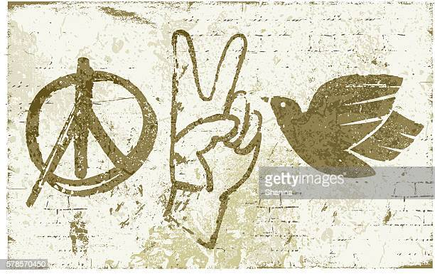 peace symbols graffiti wall - peace sign stock illustrations, clip art, cartoons, & icons