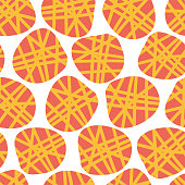 Peach and yellow irregular shaped dots on a white background. Vector seamless pattern. Great for fabric prints, paper projects, and packaging.