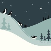 Penguins Sledding Down a Snowy Hill at Night